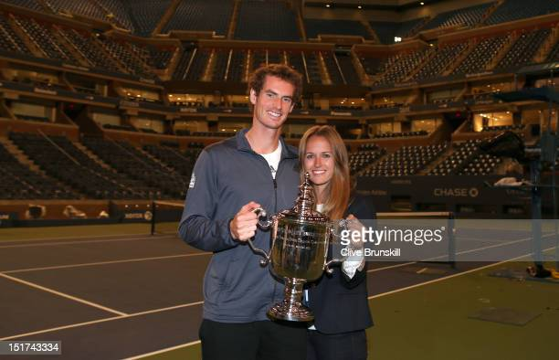 Andy Murray of Great Britain poses with the US Open championship trophy along with his girlfriend Kim Sears during Day Fifteen of the 2012 US Open at...