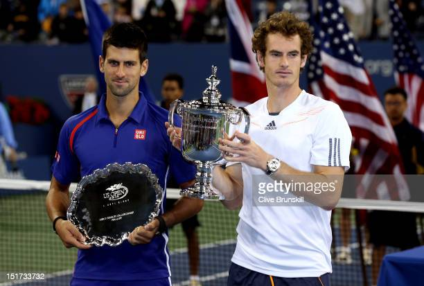 Andy Murray of Great Britain poses with the US Open championship trophy next to Novak Djokovic of Serbia after his victory in the men's singles final...