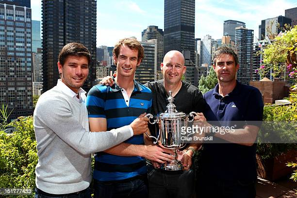 Andy Murray of Great Britain poses with the US Open Championship trophy next to Daniel Vallverdu Andy Ireland and Jez Green during his New York City...