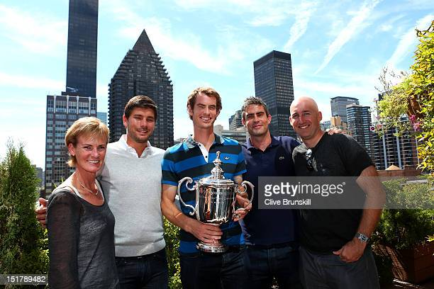 Andy Murray of Great Britain poses with the US Open Championship trophy next to mother Judy Murray Daniel Vallverdu Andy Ireland and Jez Green during...