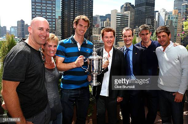 Andy Murray of Great Britain poses with the US Open Championship trophy next to Jez Green mother Judy Murray manager Simon Fuller British...