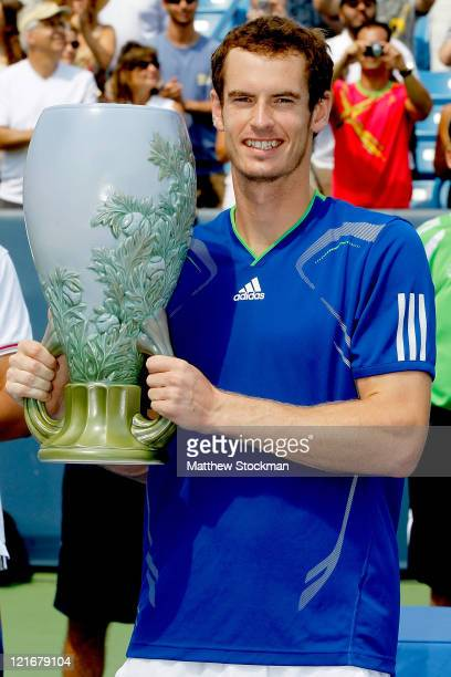 Andy Murray of Great Britain poses with the winner's trophy after defeating Novak Djokovic of Serbia during the final of the Western Southern Open at...