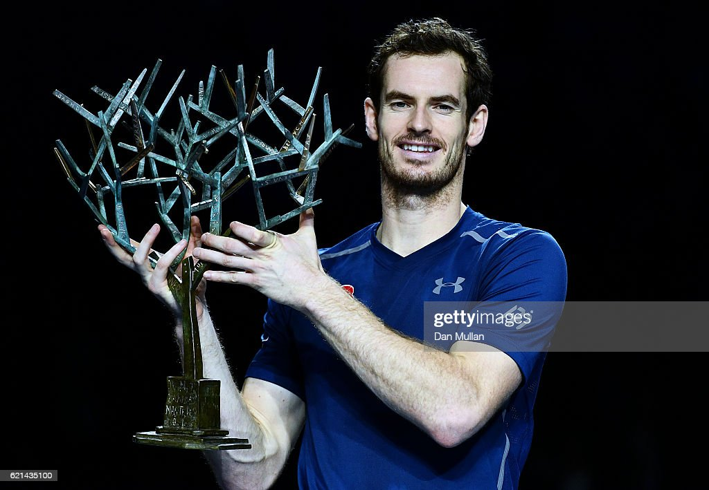 Andy Murray of Great Britain poses with 'Tree of Fanti' Trophy after winning the Mens Singles Final against John Isner of the United States on day seven of the BNP Paribas Masters at Palais Omnisports de Bercy on November 6, 2016 in Paris, France.