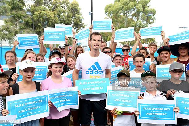 Andy Murray of Great Britain poses with young fans from Alice Springs after a practice session during day three of the 2014 Australian Open at...