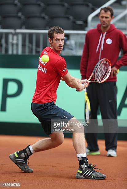 Andy Murray of Great Britain practices before his first round match against the United States prior to the Davis Cup World Group first round between...
