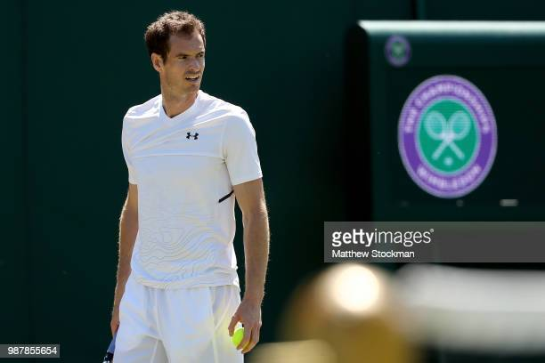 Andy Murray of Great Britain practices on court during training for the Wimbledon Lawn Tennis Championships at the All England Lawn Tennis and...