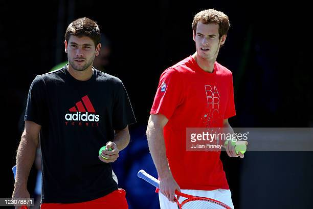 Andy Murray of Great Britain practices with Daniel Vallverdu of Venezuela during Day Two of the 2011 US Open at the USTA Billie Jean King National...