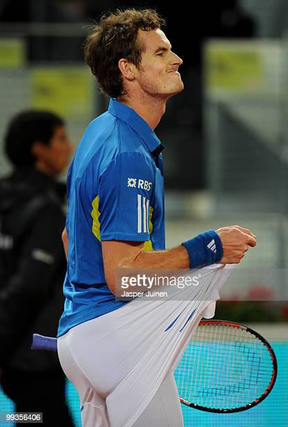 Andy Murray of Great Britain pulls his shorts as he looses a point to David Ferrer of Spain in their quarter final match during the Mutua Madrilena...
