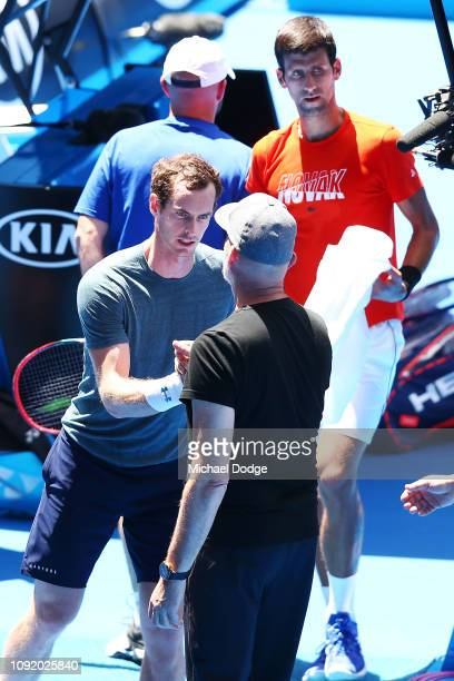 Andy Murray of Great Britain pulls out of his practice match against Novak Djokovic of Serbia ahead of the 2019 Australian Open at Melbourne Park on...