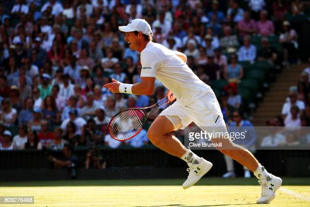 Andy Murray of Great Britain races to the net during the Gentlemen's Singles second round match against Dustin Brown of Germany on day three of the...