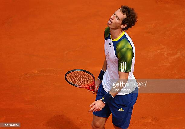 Andy Murray of Great Britain reacts after a point during his second round match against Marcel Granollers of Spain on day four of the Internazionali...