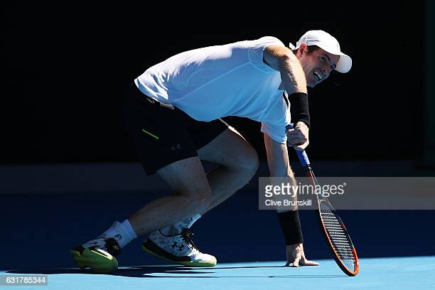 Andy Murray of Great Britain reacts after losing his footing in his first round match against Illya Marchenko of the Ukraine on day one of the 2017...