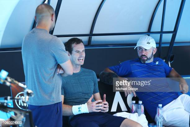 Andy Murray of Great Britain reacts after pulling out of his practice match against Novak Djokovic of Serbia ahead of the 2019 Australian Open at...