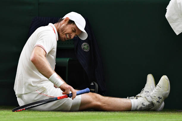 Andy Murray of Great Britain reacts after slipping over in his Men's Singles Second Round match against Oscar Otte of Germany during Day Three of The...