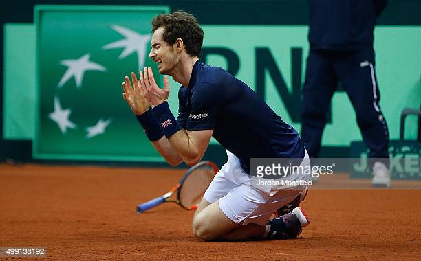 Andy Murray of Great Britain reacts after winning his match to secure the Davis Cup during day three of the Davis Cup Final match between Belgium and...
