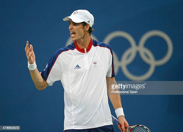 Andy Murray of Great Britain reacts against Lu YenHsun of Chinese Taipei during the Men's Singles First Round match at the Olympic Green Tennis...