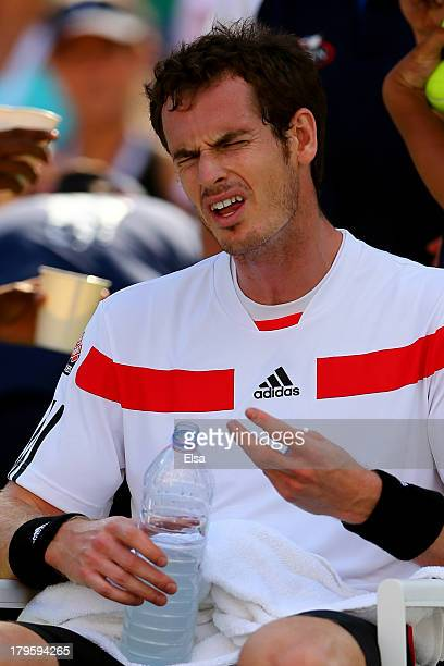 Andy Murray of Great Britain reacts during a break in his men's singles quarterfinal match against Stanislas Wawrinka of Switzerland on Day Eleven of...