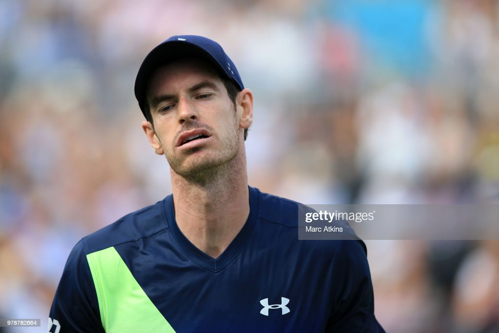 Andy Murray of Great Britain reacts during his defeat to Nick Kyrgios of Australia during Day 2 of the Fever-Tree Championships at Queens Club on June 19, 2018 in London, United Kingdom.