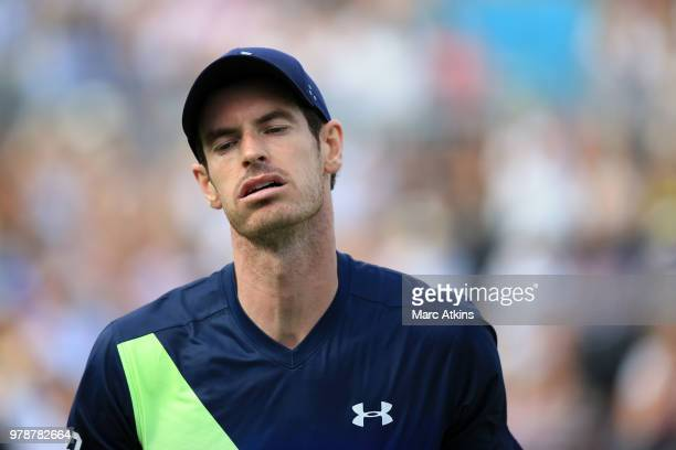 Andy Murray of Great Britain reacts during his defeat to Nick Kyrgios of Australia during Day 2 of the FeverTree Championships at Queens Club on June...