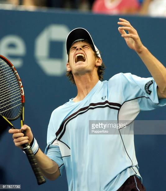 Andy Murray of Great Britain reacts during his first round match against Andrei Pavel of Romania at the US Open at the USTA National Tennis Center in...