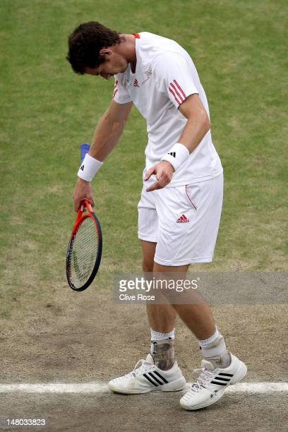 Andy Murray of Great Britain reacts during his Gentlemen's Singles final match against Roger Federer of Switzerland on day thirteen of the Wimbledon...
