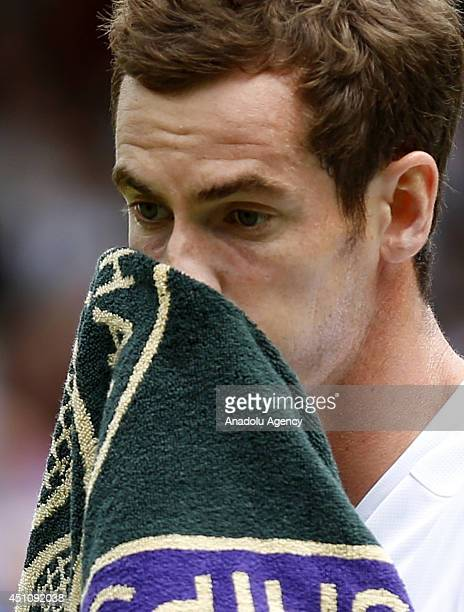 Andy Murray of Great Britain reacts during his Gentlemen's Singles first round match against David Goffin of Belgium on day one of the Wimbledon Lawn...