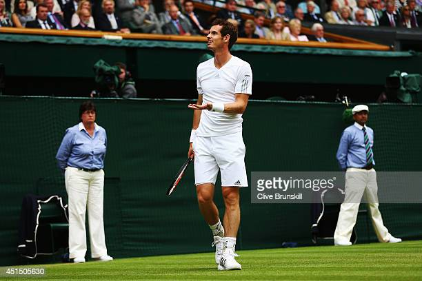 Andy Murray of Great Britain reacts during his Gentlemen's Singles fourth round match against Kevin Anderson of South Africa on day seven of the...