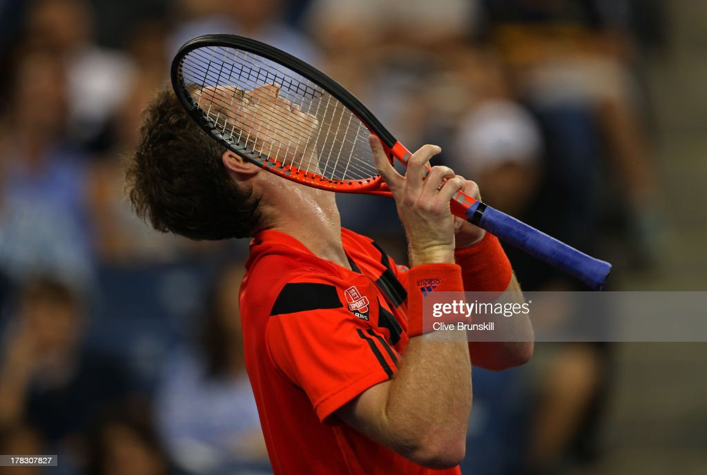 Andy Murray of Great Britain reacts during his men's singles first round match against Michael Llodra of France on Day Three of the 2013 US Open at USTA Billie Jean King National Tennis Center on August 28, 2013 in the Flushing neighborhood of the Queens borough of New York City.