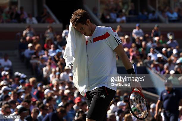 Andy Murray of Great Britain reacts during his men's singles quarterfinal match against Stanislas Wawrinka of Switzerland on Day Eleven of the 2013...