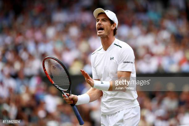 Andy Murray of Great Britain reacts during the Gentlemen's Singles fourth round match against Benoit Paire of France on day seven of the Wimbledon...