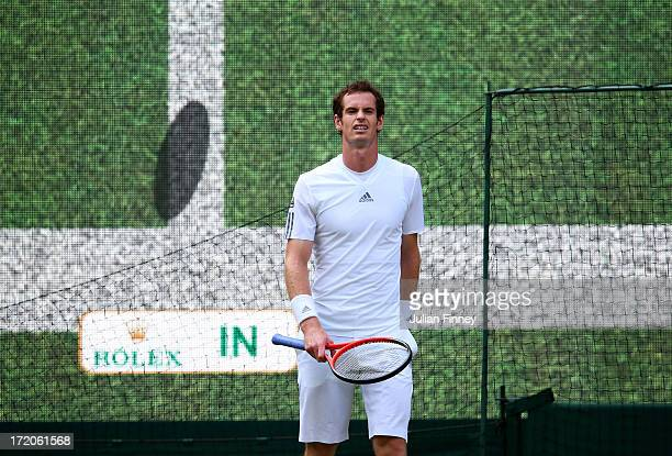 Andy Murray of Great Britain reacts to a decision from HawkEye during the Gentlemen's Singles fourth round match against Mikhail Youzhny of Russia on...