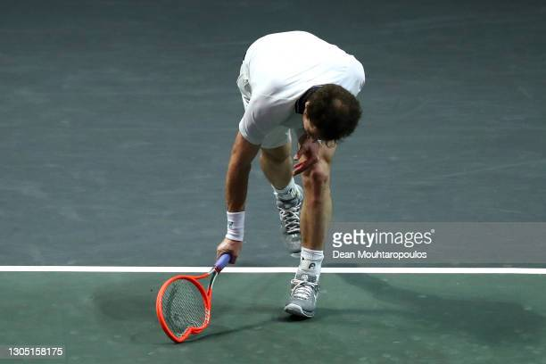 Andy Murray of Great Britain reacts to a missed point in his match by breaking his racquet or racket against Andrey Rublev of Russia during Day 3 of...