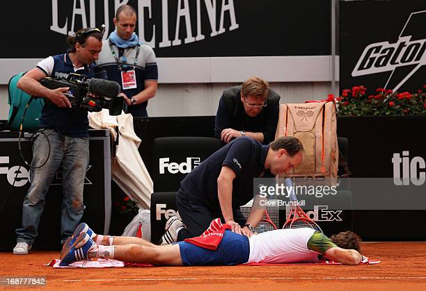 Andy Murray of Great Britain receives an injury timeout against Marcel Granollers of Spain in their second round match during day four of the...
