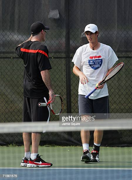 Andy Murray of Great Britain receives instruction from coach Brad Gilbert during practice on day 2 of the Legg Mason Tennis Classic, at the William...