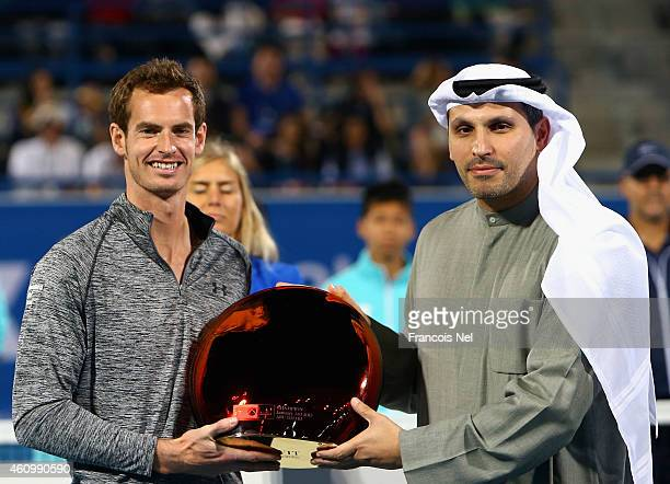 Andy Murray of Great Britain receives the trophy from Khaldoon Al Mubarak CEO of Mubadala after winning the Mubadala World Tennis Championship at...