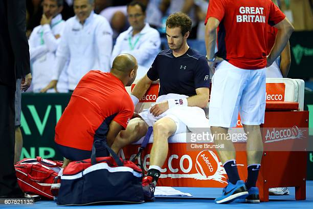 Andy Murray of Great Britain receives treatment on court for an injury during his singles match against Guido Pella of Argentina during day three of...