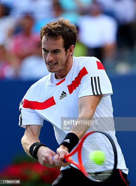 Andy Murray of Great Britain returns a backhand during his men's singles quarterfinal match against Stanislas Wawrinka of Switzerland on Day Eleven...