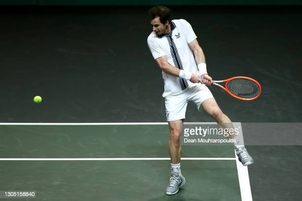 Andy Murray of Great Britain returns a backhand in his match against Andrey Rublev of Russia during Day 3 of the 48th ABN AMRO World Tennis...