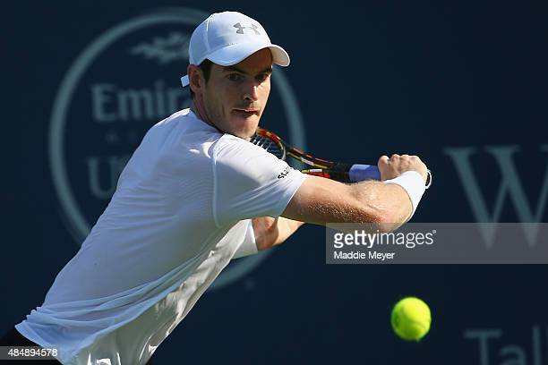 Andy Murray of Great Britain returns a backhand to Roger Federer of Switzerland during the semifinals on Day 8 of the Western Southern Open at the...