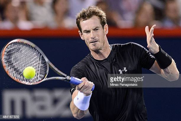 Andy Murray of Great Britain returns a hit against Kei Nishikori of Japan during day six of the Rogers Cup at Uniprix Stadium on August 15 2015 in...