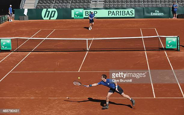 Andy Murray of Great Britain returns a serve from Kyle Edmund during a practice session prior to the Davis Cup World Group first round between the...