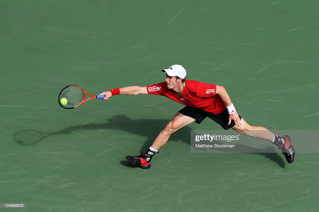 Andy Murray of Great Britain returns a shot against Donald Young of the United States during Day Eleven of the 2011 US Open at the USTA Billie Jean King National Tennis Center on September 8, 2011 in the Flushing neighborhood of the Queens borough of New York City.