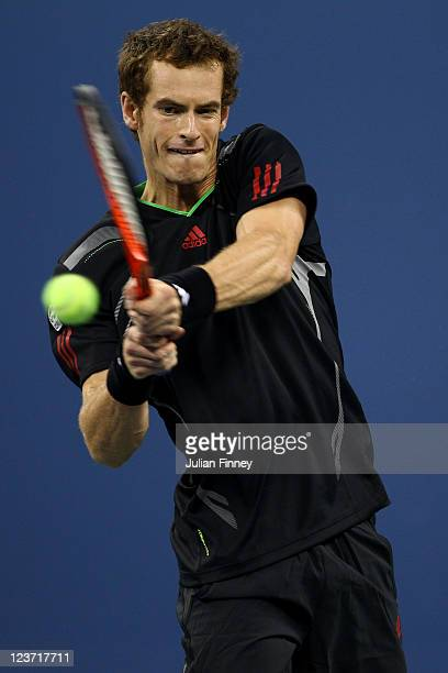 Andy Murray of Great Britain returns a shot against Feliciano Lopez of Spain during Day Seven of the 2011 US Open at the USTA Billie Jean King...
