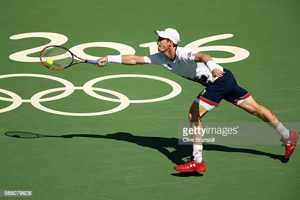Andy Murray of Great Britain returns a shot against Kei Nishikori of Japan during the Men's Singles Semifinal Match on Day 8 of the Rio 2016 Olympic...