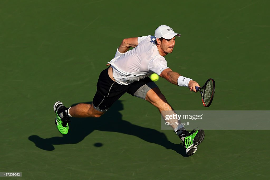 Andy Murray of Great Britain returns a shot against Kevin Anderson of South Africa during their Men's Singles Fourth Round match on Day Eight of the 2015 US Open at the USTA Billie Jean King National Tennis Center on September 7, 2015 in the Flushing neighborhood of the Queens borough of New York City.