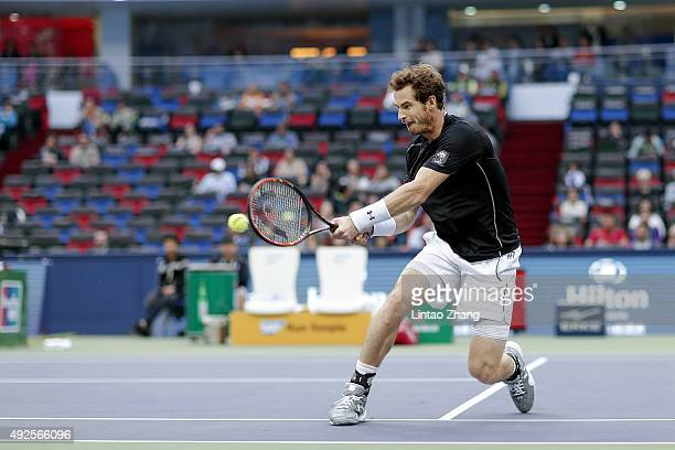 Andy Murray of Great Britain returns a shot against Steve Johnson of the United States during the men's singles second round match on day 4 of...