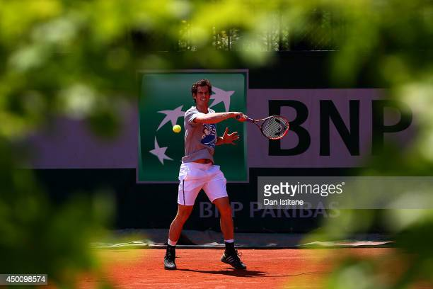 Andy Murray of Great Britain returns a shot during a practice session on day twelve of the French Open at Roland Garros on June 5, 2014 in Paris,...