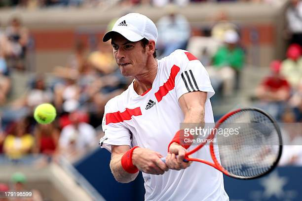Andy Murray of Great Britain returns a shot during his men's singles third round match against Florian Mayer of Germany on Day Seven of the 2013 US...