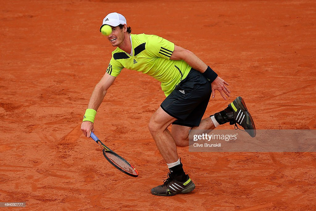 Andy Murray of Great Britain returns a shot during his men's singles match against Andrey Golubev of Kazakhstan on day three of the French Open at Roland Garros on May 27, 2014 in Paris, France.
