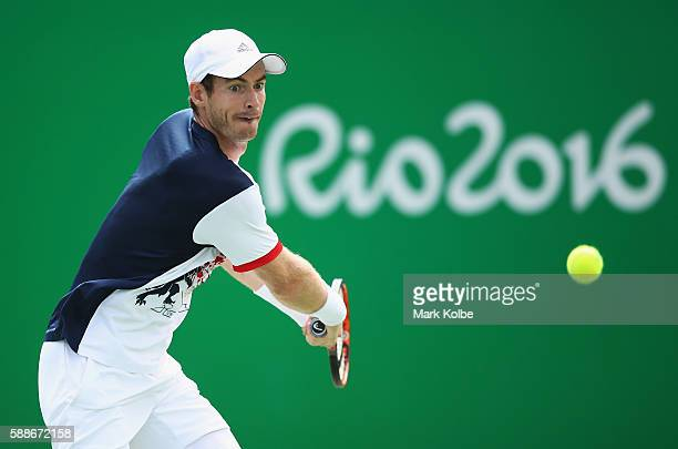 Andy Murray of Great Britain returns a shot during the match against Steve Johnson of the United States in the Men's Singles Quarterfinal on Day 7 of...